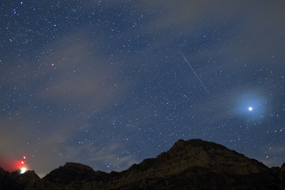 A Shooting Star Above the Saentis Mountain, Switzerland Photographic Print by Alessandro Della Bella