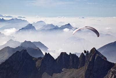 A Paraglider Photographic Print by Arno Balzarini