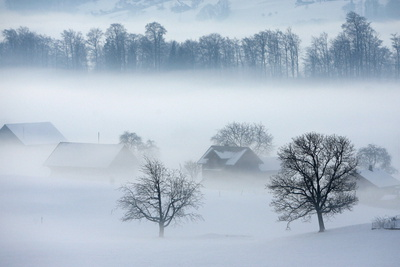 Fog Surrounds the Landscape around the Town Kerns in Central Switzerland Photographic Print by Urs Flueeler