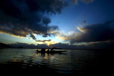 A Kashmiri Fisherman Rows His Boat on Dal Lake in Srinagar, the Summer Capital of Indian Kashmir Photographic Print by Farooq Khan