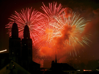 Photograph of Fireworks Lighting the Sky Near the Grossmuenster Church in Zurich, Switzerland
