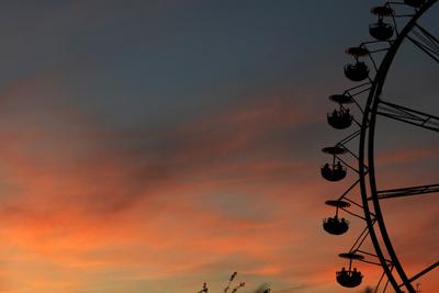A Ferris Wheel at Sunset Photographic Print by Matthias Hiekel