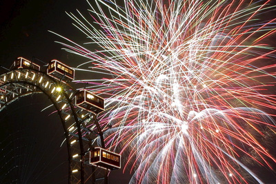 Photograph of Fireworks Exploding over Vienna's 'New Year's Eve Path' with Ferris Wheel Turning