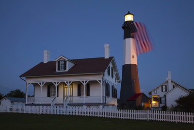 USA, Georgia, Tybee Island, Flag flying on lighthouse at Tybee Island. Photographic Print by Joanne Wells
