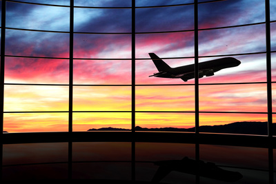 Airport Window with Airplane Flying at Sunset Photographic Print by  viperagp