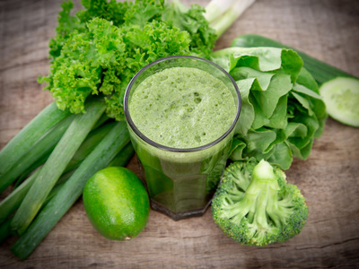 Healthy Green Vegetable Juice on Wooden Table Photographic Print by  Kesu01