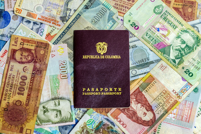 Colombian Passport and Money Photographic Print by  jkraft5