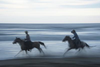 A Cowboy Rides a Horse Through the Waves on Virginia Beach, Virginia Photographic Print by Joel Sartore