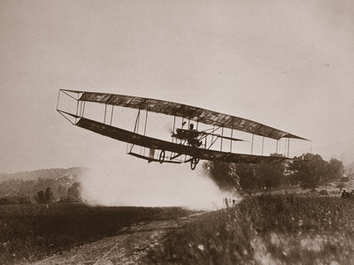 Glenn Curtiss Making the First Heavier-Than-Air Flight in the June Bug Photographic Print
