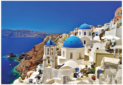 Santorini white buildings along greek coastline, popular college travel destination