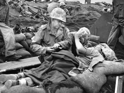 Navy Doctor and Corpsman Treat a Wounded Marine on Iwo Jima. Feb. 19-March 26 Photo