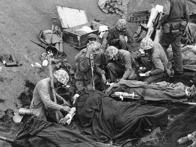Navy Doctors and Corpsmen Treat Seriously Wounded Marines on Iwo Jima Photo