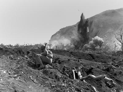 Marines Blast Jap Positions Near the Base of Mount Suribachi on Iwo Jima Photo