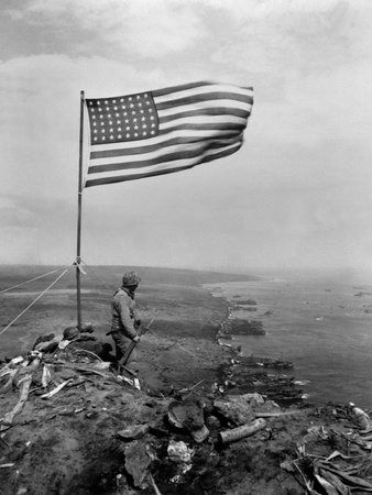Stars and Stripes Wave over the Summit of Mt. Suribachi on Iwo Jima Photo