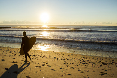 A Young Male Surfer Walks Along the Beach at End of Long Beach Island, New Jersey Photographic Print by Vince M. Camiolo