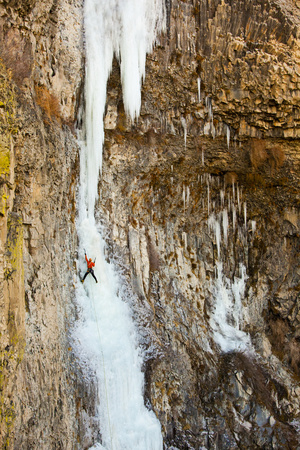 A Male Ice Climber on the First Pitch of Zenith Ice Route Near Banks Lake in Washington Photographic Print by Ben Herndon