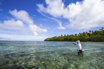 A Male Angler Making Casts on a Saltwater Flat at Alphonse Island, Seychelles Photographic Print by Matt Jones
