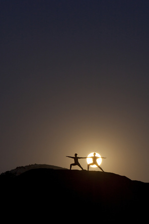 Man and Woman Practice Yoga in Front of a Full Moon in Grand Canyon National Park, Arizona Photographic Print by Louis Arevalo