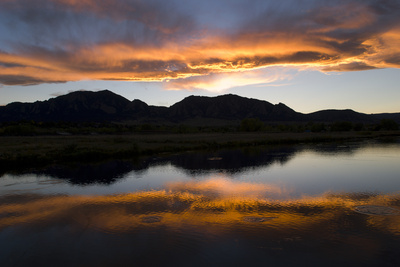 A Sunset over the Rocky Mountains Is Reflected in a Lake Near Boulder, Colorado Photographic Print by Sergio Ballivian