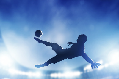 Football, Soccer Match. A Player Shooting on Goal Performing a Bicycle Kick. Lights on the Stadium Photographic Print by PHOTOCREO Michal Bednarek