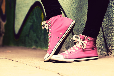 Close up of Pink Sneakers Worn by a Teenager. Grunge Graffiti Wall, Concepts of Teen Rebel, Problem Photographic Print by PHOTOCREO Michal Bednarek