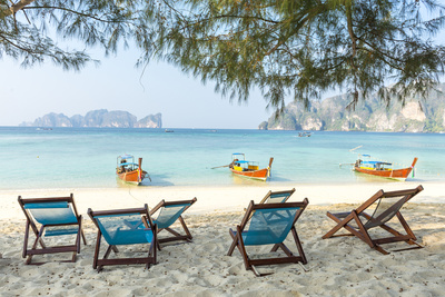 Beach Chairs and Boats at Koh Lipe beach coastline - Buy Photo Poster