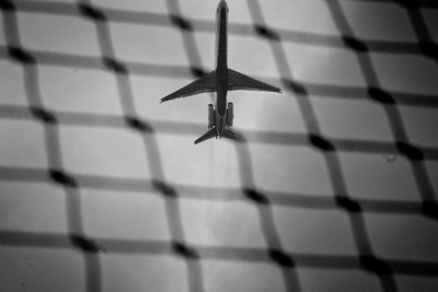 Airplane Through Fence B/W Photo