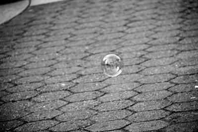 Bubble Floating Above Sidewalk Photo