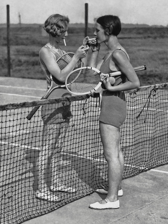 Lighting up after A Tennis Match Photographic Print by  FPG
