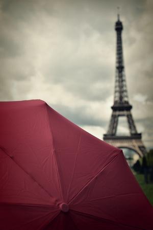 Eiffel Tower and Red Umbrella Photographic Print by Photo by Ira Heuvelman-Dobrolyubova