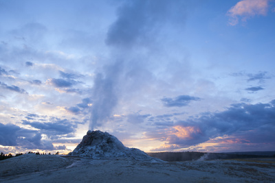 Geyser Erupts at Sunset in Yellowstone NP Photographic Print by Noah Clayton