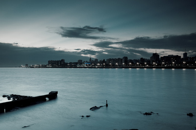 Waterfront at Dusk, View from La Rambla, Montevideo, Uruguay, February 2009 Photographic Print by Walter Bibikow