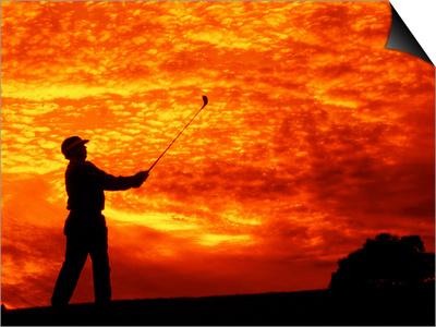 Man Swinging Golf Club at Sunset Prints by Bill Bachmann