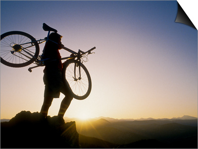 Silhouette of Mountain Biker at the Summit During Sunrise Prints