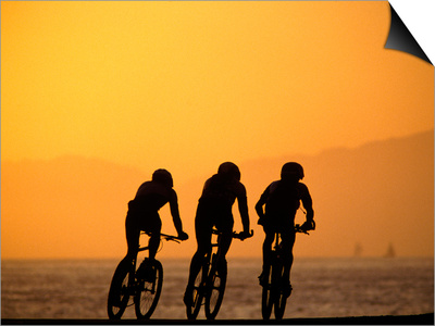 Silhouette of Three Men Riding on the Beach Prints by Mitch Diamond