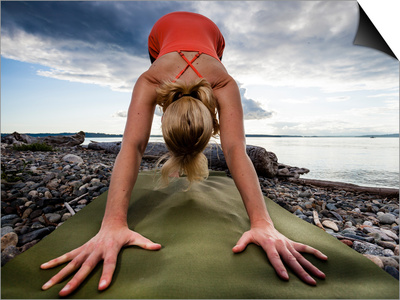 Lisa Eaton Holds a Downward Dog Yoga Pose on the Beach of Lincoln Park - West Seattle, Washington Posters by Dan Holz