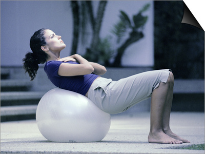 Side Profile of a Young Woman Exercising on a Fitness Ball Poster