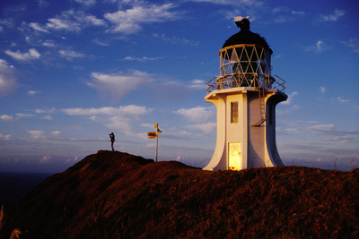 Dawn Light falling on the Lighthouse. Fotografisk tryk af Paul Kennedy