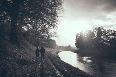 A Couple Walking Along a Canal on a Wet Day Photographic Print by Clive Nolan