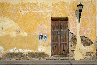 Broken Plaster on Yellow Wall with Old Wood Door Photographic Print by Thom Lang