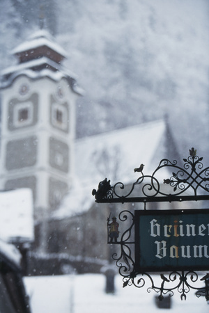 Austria, Salzkammergut, Hallstatt Church with Snow Photographic Print by Walter Bibikow