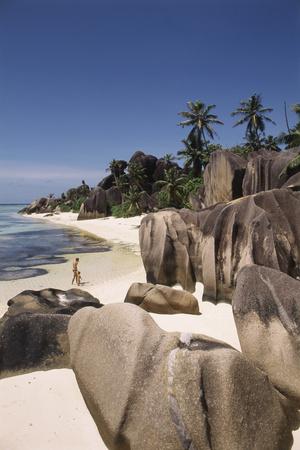 Seychelles, La Digue Island, Man and Child on Beach Photographic Print by Nik Wheeler