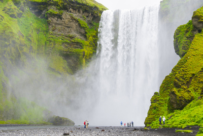 Iceland. South. Skogafoss. Hikers are Skogafoss Waterfall Photographic Print by Inger Hogstrom