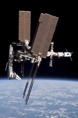 The International Space Station in Orbit Above Earth Photographic Print