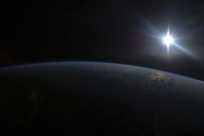 View from Space of the Sun Setting over Earth's Horizon Photographic Print