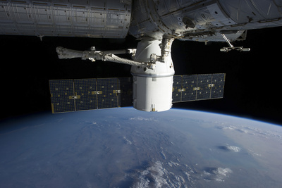 Spacex Dragon During its Docking with the International Space Station Photographic Print