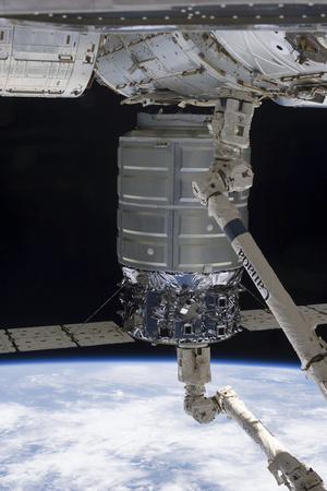 Canadarm2 Robotic Arm Unberths the Cygnus Spacecraft Photographic Print