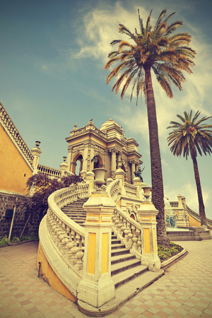 Santiago De Chile, Old Building with Palms on the Blue Sky, Vintage Retro Style. Photographic Print by Maciej Bledowski