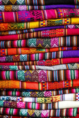 Colorful Carpets Made of Llama and Alpaca Wool for Sale at San Pedro Market, Cuzco, Peru. Photographic Print by Yadid Levy