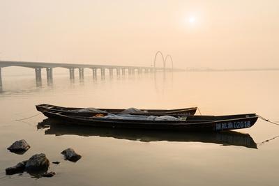 Fishing Boats and Modern Bridge in Mist at Qiantangjiang River in Hangzhou, Zhejiang, China, Asia Photographic Print by Andreas Brandl